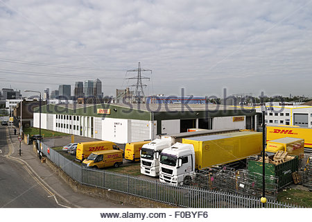 DHL depot at the Europa Trade Park with distant view of Canary Wharf: Canning Town, London. - Stock Photo