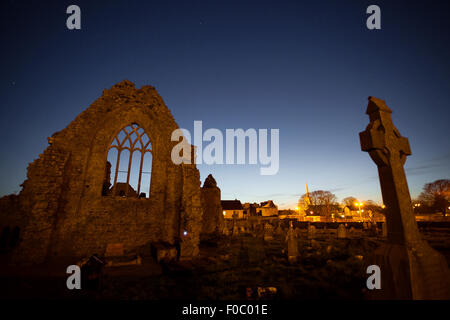 Night view of Athenry Dominican Friary, dedicated to Saints Peter and Paul,found at 1241, with cemetery. - Stock Photo