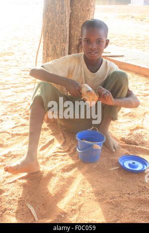 BANDIAGARA, MALI - SEPTEMBER 30, 2008:  Unidentified boy eating in bandiagara in the Mopti region in Mali on september - Stock Photo