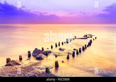 Beautiful sunset over Baltic Sea, Dziwnowek in Poland. - Stock Photo