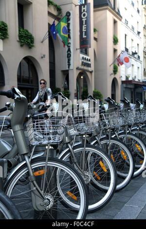 Vélib' Paris Bike sharing program in Paris.20 000 Bikes Bycicles covering the city. - Stock Photo