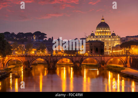 Sunset at Pont St Angelo and St Peters Basilica Vatican city Rome Lazio Italy EU Europe - Stock Photo