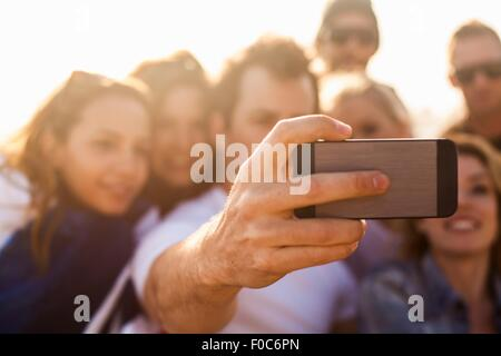 Group of friends taking selfie on beach - Stock Photo