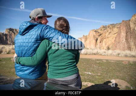 Couple enjoying scenery, Smith Rock State Park, Oregon - Stock Photo