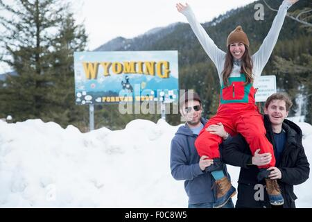 Men carrying woman on shoulder, Jackson Hole, Wyoming - Stock Photo