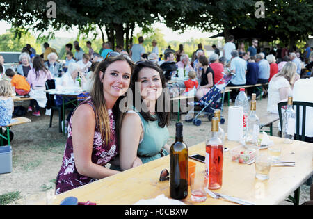 Young women 20s friends enjoying holiday together at Picnic evening at Loubejac which is a small village in the - Stock Photo