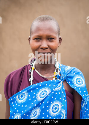 Young Maasai woman in traditional everyday clothes in her boma (village) in Tanzania, Afric - Stock Photo