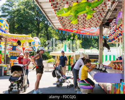 Strollers, Victorian Gardens, Carnival in Central Park, NYC Stock ...