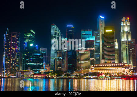 Singapore Downtown Core reflected in the river. Republic of Singapore - Stock Photo