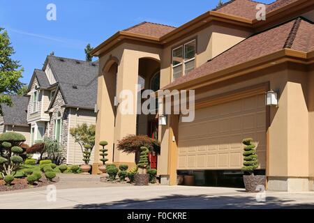 Open garage door in suburban family home - Stock Photo