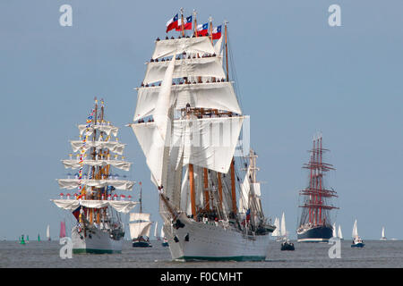 Bremerhaven, Germany. 12th Aug, 2015. The tall ship 'Esmeralda' from Chile, Middle, sails in front of other windjammers - Stock Photo