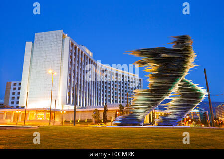 Statue in front of hotel Hilton in Evangelismos in central Athens - Stock Photo