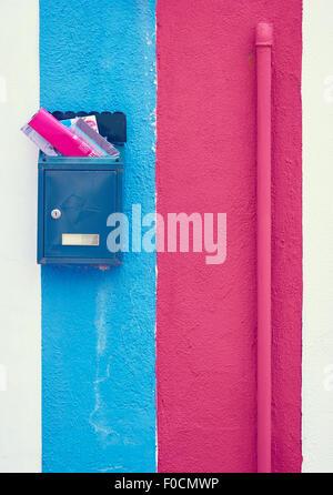 Magazines in mailbox of blue and pink painted Burano house Venetian Lagoon Veneto Italy Europe - Stock Photo