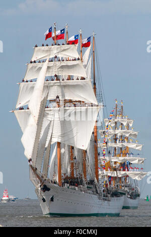 Bremerhaven, Germany. 12th Aug, 2015. The tall ship 'Esmeralda' from Chile sails in front of the windjammer  'Gloria' - Stock Photo