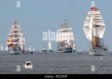 Bremerhaven, Germany. 12th Aug, 2015. The tall ship 'Esmeralda' from Chile, right, sails in front of other windjammers - Stock Photo