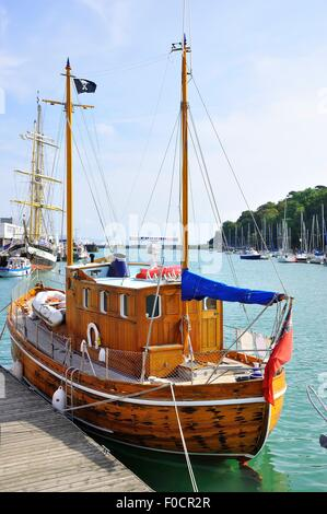 Flapper 111. A small, two masted timber built sailing boat moored in the harbour at Weymouth, Dorset, England - Stock Photo