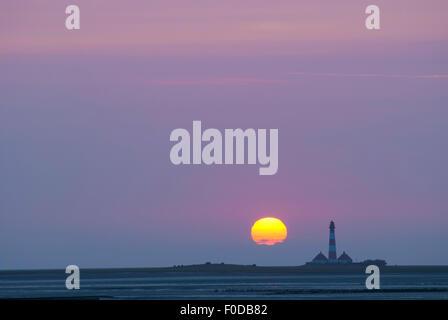 Westerhever lighthouse at sunset, Westerheversand, Tümlauer Bay behind, Tümlauer-Koog, Schleswig-Holstein, Germany - Stock Photo