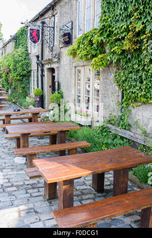 Seats outside the Red Lion Hotel Burnsall North Yorkshire England - Stock Photo
