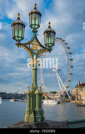 Southbank Westminster Bridge Millennium Wheel London Eye Ferris Victorian street gas light lights River Thames boat - Stock Photo