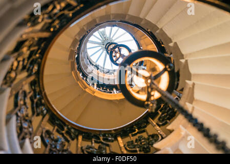 London Southbank Greenwich Maritime Royal Naval College neo classical Chapel spiral helical staircase centre lights - Stock Photo
