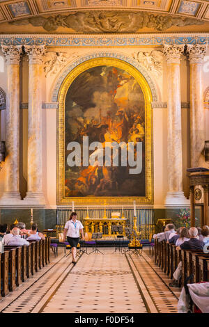 London Southbank Greenwich Maritime Royal Naval College neo classical Chapel interior altar painting congregation - Stock Photo