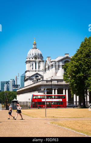 London Southbank Greenwich Maritime Royal Naval College neo classical Chapel red double decker bus aspect from The - Stock Photo