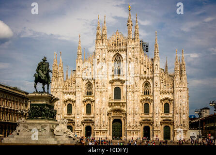 Milan cathedral with the rear view of King Victor's statue in the foreground. - Stock Photo