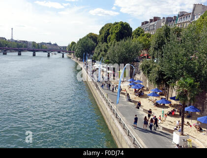 Artificial beach for summer along banks of River Seine in Paris, France - Stock Photo