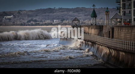 High tide and wind batter the promenade at Swansea bay, South Wales, UK - Stock Photo