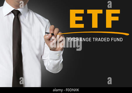 ETF is written by businessman background. - Stock Photo