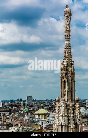 Statue on the roof of Milan Cathedral. - Stock Photo