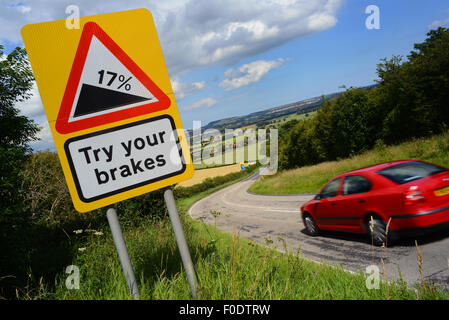 car passing try your brakes warning sign above staxton hill yorkshire united kingdom - Stock Photo