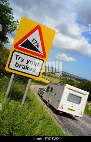 caravan passing try your brakes warning sign above staxton hill yorkshire united kingdom - Stock Photo
