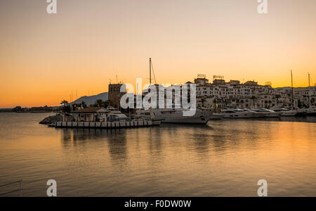 The Luxury marina of Puerto Banus harbour in Marbella at sunset. Andalusia, Spain. - Stock Photo