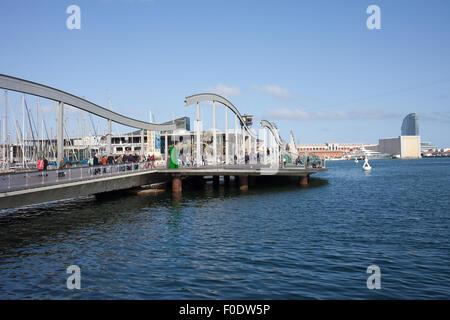 Rambla de Mar promenade at Port Vell in the city of Barcelona, Catalonia, Spain. - Stock Photo