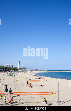 People playing volleyball on a beach in Barcelona, Catalonia, Spain. - Stock Photo