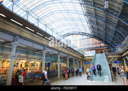 Inside the grade 1 listed St Pancras Railway Station with glazed roof - Stock Photo