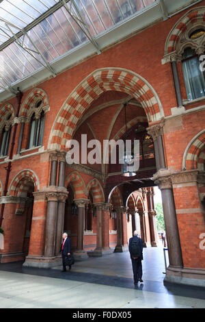 Interior arched entrance to the Grade 1 Listed St Pancras Railway Station in London - Stock Photo