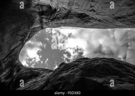 Cave Point Escalante Looking up at the sky from the inside Horizontal Black and White - Stock Photo