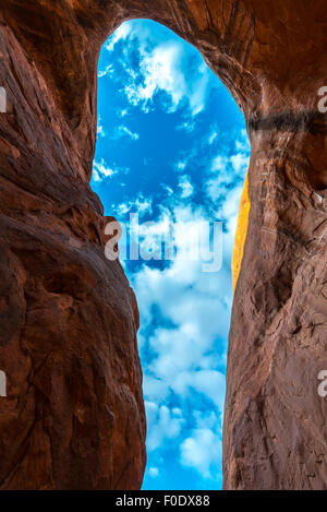 Cave Point Escalante Looking up at the sky from the inside Vertical - Stock Photo