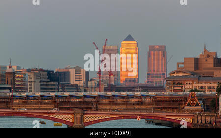 View from Waterloo Bridge looking towards Canary Wharf  and Blackfriars Bridge as the late afternoon sunlight reflects - Stock Photo
