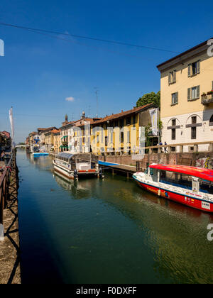 Moored boats on the canal in the Navigli district of Milan. Italy. - Stock Photo
