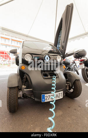 Renault Twizy electric car recharging its batteries at a demonstration day for sustainable transport in Adeje, Tenerife, - Stock Photo