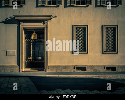 Italian building with shuttered windows. - Stock Photo