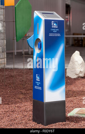 Electric vehicle recharging point as provided by Spanish power company Endesa at a sustainable transport demo in - Stock Photo