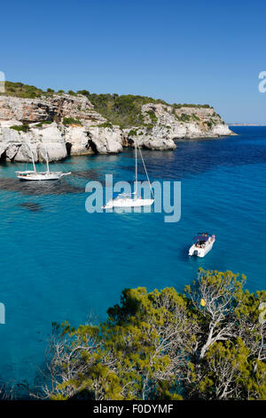 Yachts anchored in cove, Cala Macarella, near Cala Galdana, South West Coast, Menorca, Balearic Islands, Spain, - Stock Photo