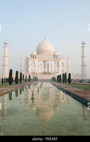 Agra, Utar Pradesh, India. The Taj Mahal seen from the end of the al Hawd al-Kawthar tank, with its reflection, - Stock Photo