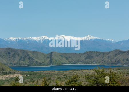 Lake Motosu and snow capped mountains in Japan - Stock Photo