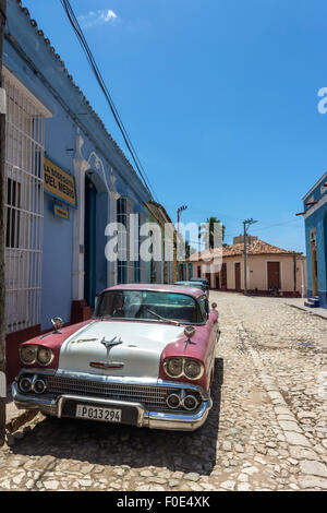Classic car parked on road in Trinidad, Cuba - Stock Photo