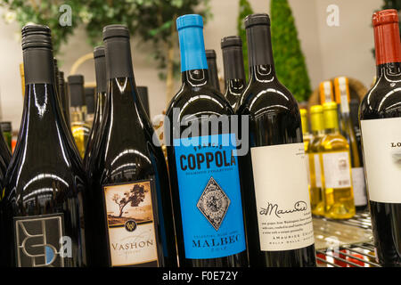 Bottles of wine for sale, including a Francis Coppola Malbec. - Stock Photo